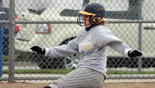 Sheboygan North's Allison Schetter (7) slides into third base during action against Plymouth at the Sheboygan County Softball Invitational on Saturday.