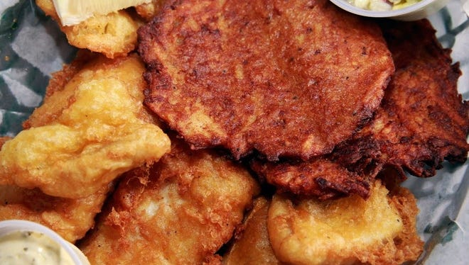 Fish fry with potato pancakes,  Wisconsin's Friday night ritual.