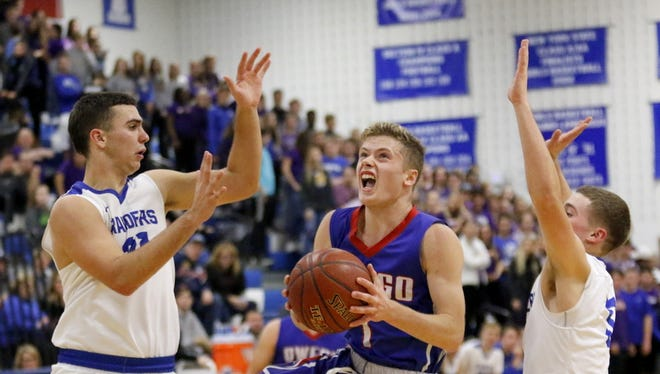 Christian Sage of Owego drives between Horseheads defenders Nate VanBrunt, left, and Lewis Clearwater on Dec. 7 at Horseheads Middle School.