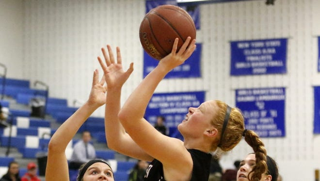 Caylee Boorse of Elmira goes up for a shot as Jenna Granger of Horseheads defends Tuesday during the Express' 67-43 win at Horseheads Middle School.