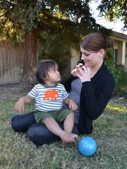 Taylor Galanti, ASL teacher for DHHSC with Benjamin Rivera, 13 months old.