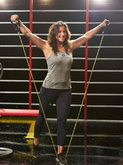 Samantha Kelman of Birmingham works out on the set