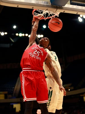 Mar 10, 2016; Birmingham, AL, USA; Western Kentucky Hilltoppers guard Fredrick Edmond (25) dunks the ball against UAB Blazers at Legacy Arena. The Hilltoppers defeated the Blazers 88-77. Mandatory Credit: Marvin Gentry-USA TODAY Sports