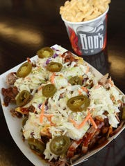 The meat on the Pulled Pork Nachos is from a bone-in