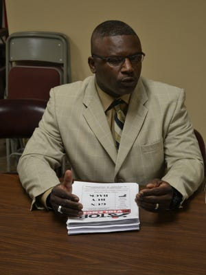 The Rev. Randy Harris, pastor at Mount Triumph Baptist Church, discusses the upcoming gun buyback program to be held at his Alexandria church on Saturday, May 14.