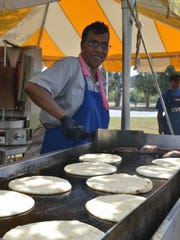 Monique Leal of Anderson cooks gyros on the grill Saturday afternoon at the Anderson Greek Festival.