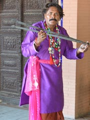 A Pakistani folk singer plays the chimta or musical fire tongs, at the Lok Visra Folk Heritage Museum in  Islamabad, Pakistan