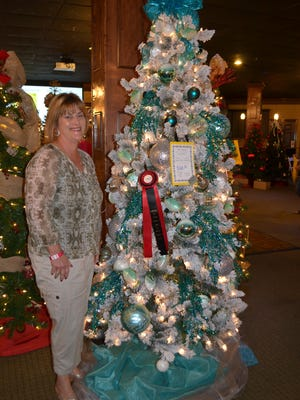 Jan Reed, owner of Beach House Designs in Satellite Beach, shows her tree at Festival of Trees, where she won Best in Show.