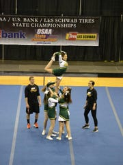 Regis High School standing tall at the State Cheer Championships.