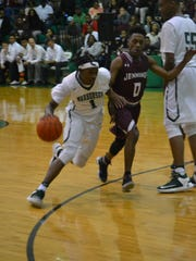 Peabody senior guard Cedric Russell (1) drives to the