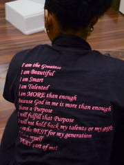 Angel's Elite Modeling Troupe's affirmation is on the back of its T-shirts.