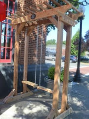 Smoking Mo's outdoor seating area includes swings,