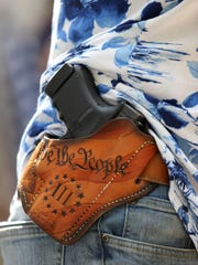 """Matt Marshall, leader of the Washington 3%, carried a holstered firearm while attending the right-wing """"Liberty or Death - Rally Against Left Wing Violence"""" outside Seattle City Hall on August 18, 2018 in Seattle, Washington."""