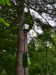 One of the many lamps that light the path at Monroe Park in Eugene, Ore.