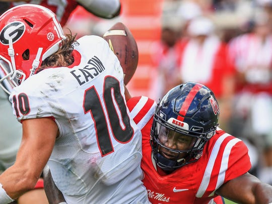 Defensive lineman Garrald McDowell, playing here for Ole Miss in red against Georgia in 2016, has come to UL as a graduate transfer for the 2018 season.
