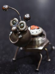 "Richard Kolb's ""Luv Bug"" sculptures feature a heart on the bug's back."