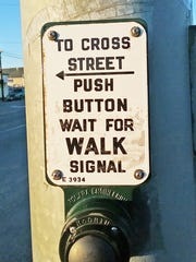 A crosswalk button at Wiliams and Laurel in Salinas, a busy intersectionnear two schools.