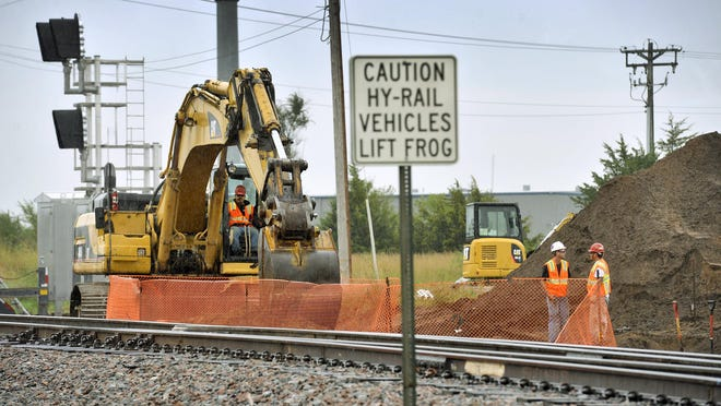 A crew works along the BNSF Railway tracks Wednesday in Becker. BNSF is adding a double railroad track between Becker and Big Lake and near Little Falls as part of its nationwide expansion effort.