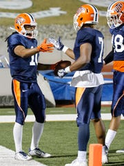 UTEP wide receiver Warren Redix celebrates with team