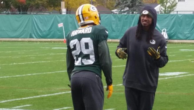 Green Bay Packers cornerback Tramon Williams, right, talks to teammate Casey Hayward during individual drills at Thursday's practice at Clarke Hinkle Field.