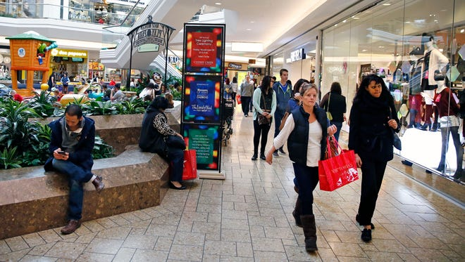 Shoppers at Cherry Creek Mall in Denver on Nov. 29.