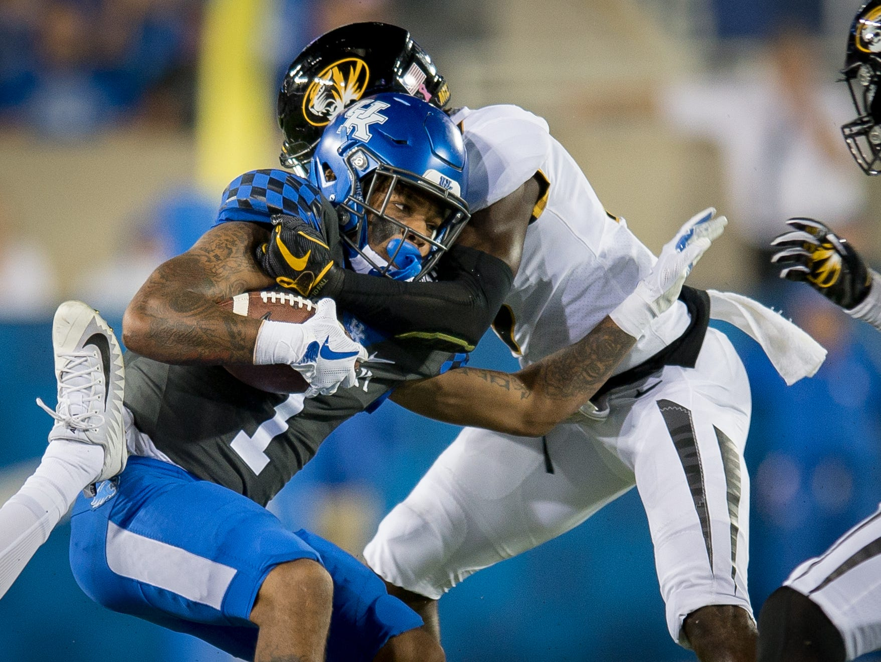 Kentucky Wildcats wide receiver Lynn Bowden Jr. (1) is tackled by several Missouri Tigers defenders during the game at Kroger Field on the campus of the University of Kentucky in Lexington, Saturday, Oct. 7, 2017.