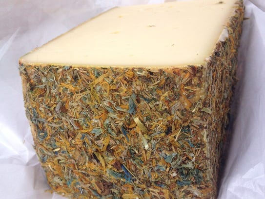 An Alpine cheese with an edible rind of dried flowers,