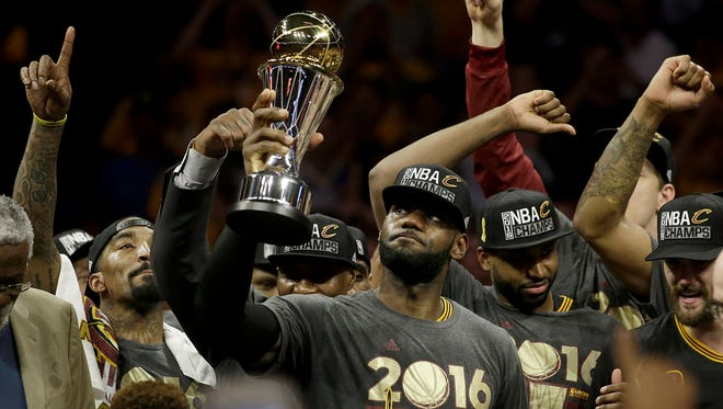Cavaliers forward LeBron James, center, celebrates with teammates after Game 7 of the NBA finals against the Warriors in Oakland, Calif., Sunday, June 19, 2016. The Cavaliers won, 93-89.