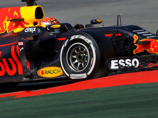 Red Bull driver Max Verstappen of the Netherlands takes a curve during a Formula One pre-season testing session at the Catalunya racetrack in Montmelo, outside Barcelona, Spain, Thursday, March 2, 2017. (AP Photo/Francisco Seco)