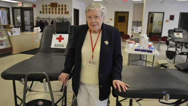 Green Bay resident Blanche Baudhuin stands in the Blood Donation Center for the American Red Cross Northeast Wisconsin Chapter in Green Bay. Baudhuin, who turns 100 on March 13, has done volunteer work at the Red Cross for about 40 years.
