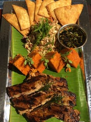 Almoguera's fiesta plate included red rice, kelaguen, titiyas, BBQ ribs and finadene