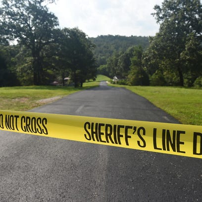Crime scene tape blocks the entrance to Baxter County