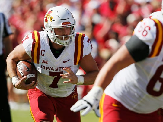 Iowa State quarterback Joel Lanning (7) carries in the first quarter of an NCAA college football game against Oklahoma in Norman, Okla., on Saturday, Oct. 7, 2017.
