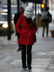 A person walks Downtown during a cold snap in January