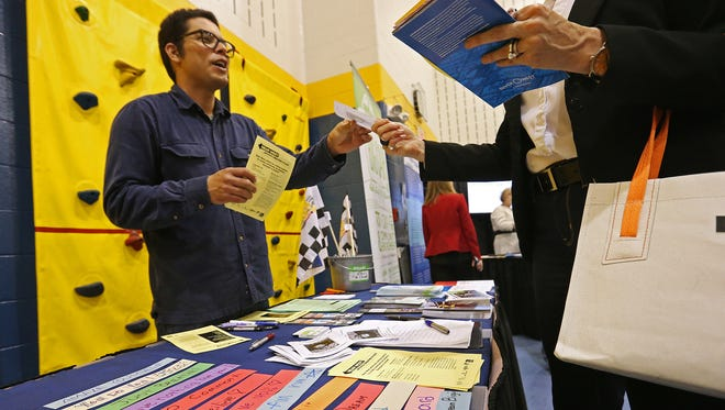 Eduardo Luna gave attendees information about Big Car Collaborative, a nonprofit arts organization, during a Great Places 2020 unveiling event Tuesday, May 10, 2016, at James Whitcomb Riley School 43 in Indianapolis.
