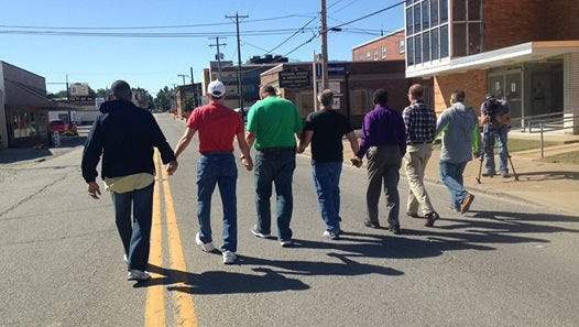 Local pastors marching during the event to promote peace and love in Union County.