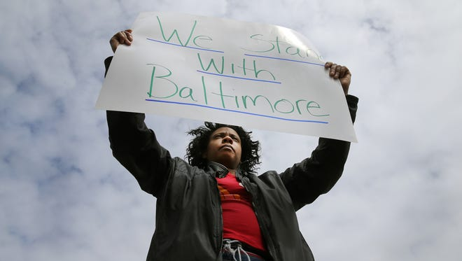 Adrianne Hamilton of Rochester took part in a protest in support of the protesters in Baltimore.