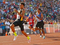 Bobby Grant of Phoenix Brophy Prep competes in the  100-meter hurdles during the Division I state track and field championships at Mesa Community College on Saturday, May 10, 2014 in Mesa, Arizona. Grant won the 200 title.