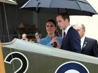 Britain's Prince William, right, and his Kate, the Duchess of Cambridge, are guided on a tour of the Omaka Aviation Heritage Centre by film director Peter Jackson, in Blenheim, New Zealand on April 10, 2014.