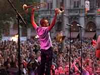 A large crowd cheers for Trombone Shorty as he takes the  stage at East and Alexander St on the final night at the Xerox Rochester International Jazz Festival.