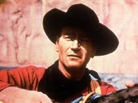 "John Wayne took all sorts of verbal abuse from bullying director John Ford on the set of The Searchers.  Warner Home Video John Wayne appears in a scene from the Warner Bros.film ""The Searchers."" (Gannett News Service/Warner Home Video/File)"