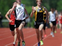 Rush-Henrietta's Mickey Burke, center, out kicks Greece Athena's Keith Pease toward the finish of the boys 800 meter run during the Class AA/A Sectionals held at Penfield High School on Saturday, May 25, 2013. Burke's time of 1:56.46 was first in Class AA and helped the Royal Comets win the Class AA team title also.