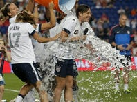 United States' Abby Wambach, right, is showered by teammates after an international friendly soccer match against South Korea at Red Bull Arena, Thursday, June 20, 2013, in Harrison, N.J. The U.S. won 5-0. Wambach is now the greatest goal scorer in international soccer.  She scored four goals in the first half to break Mia Hamm's record.
