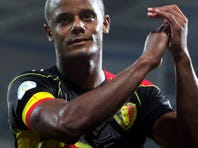 Belgium defenter Vincent Kompany salutes fans after his country's 2-0 win over Wales in Friday's World Cup qualifier. Kompany captained English club Manchester City to the Premier League title last season.