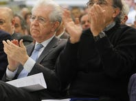 Italian Prime Minister Mario Monti (left) and Fiat and Chrysler boss Sergio Marchionne applaud a speech at Fiat's Melfi, Italy, plant today at the announcement the underutilized plant will be upgraded to build a new Jeep for export and a new Fiat model.
