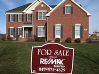A home is offered for sale by Remax Realty in a Toll Bros. housing development on Dec. 4, 2012, in South Barrington, Ill.
