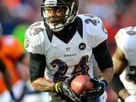 Baltimore Ravens cornerback Corey Graham (24) returns an interception for a touchdown in the first quarter against the Denver Broncos during the AFC divisional playoffs at Sports Authority Field in Denver.