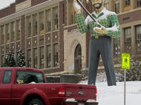 In this photo taken Jan. 15, 2013, a statue of a logger stands outside an elementary school in St. Maries, Idaho near where a survivalist group plans to build a compound.