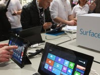 Visitors try out a Windows 8 Surface tablet at a trade fair last month in Germany.