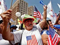 Alma Banuelos, left, with Emilia Hernandez  shout slogans during a rally in downtown Los Angeles Wednesday, May 1, 2013. In celebration of May Day thousands have gathered for an immigration reform rally in downtown Los Angeles. (AP Photo/Nick Ut) ORG XMIT: LA106